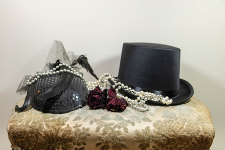 Fashion accessories, elegant hats, pink pearl necklace and buttonhole