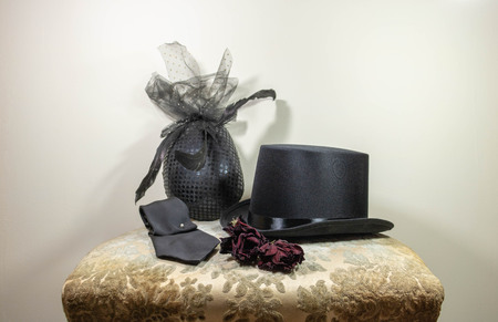 Veiled fascinator hat, hat, tie and dried buttonhole flowers