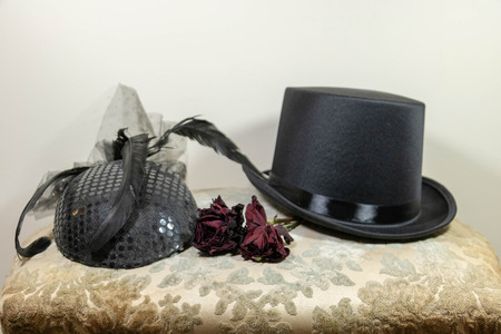 Back to a party, chic hats for gentleman and lady and dried rose for buttonhole