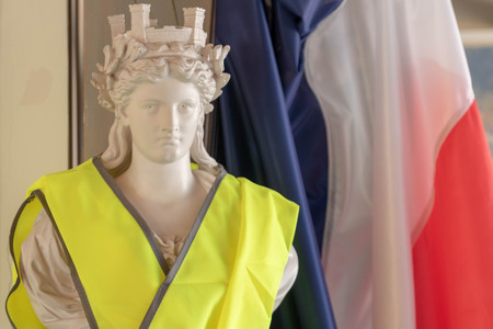 France and its symbols of the Republic against yellow vests. Marianne and the French tricolor