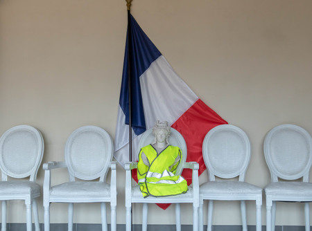 Citizen consultation, yellow vest and national debate, Marianne symbol of the French Republic with a yellow vest