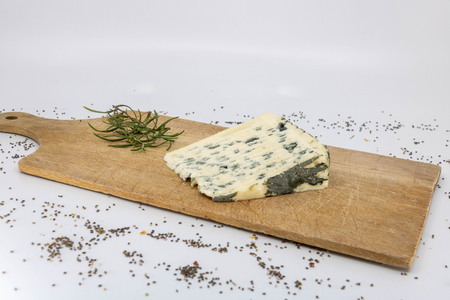 Sheep cheese, Bleu dAuvergne and fresh rosemary for French cheese tasting