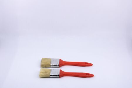 2 Flat Brushes of Different Size for House Painter - Isolated Objects on White Background for Construction Professionals and Sale of Do-It-Yourself Equipment