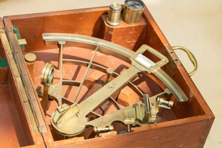 Ancient Sextant and the traditional navy for captain of a boat to make her way to the stars and to the stars