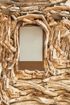 Background, graphic resource border made in driftwood branch laundered by the sea