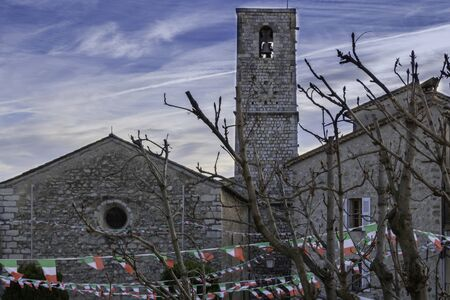 Medieval church in the heart of Provence in the hilltop villages of the Cote dAzur, Saint Jacques church in Le Bar sur Loup, France with the decorations of the Italian market
