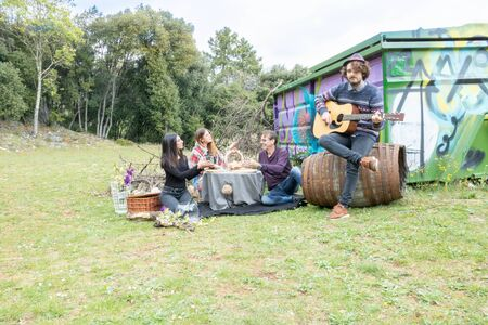 Children offering a surprise and a picnic to their fathers day, his birthday or the Harvest Festival. The son plays the guitar in the countryside in a urbex atmosphere