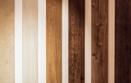 Wooden slats parquet board in different colors from varnish from lightest to darkest
