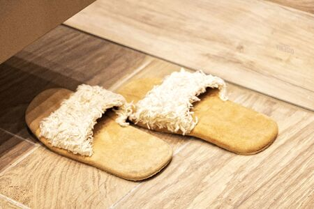Wool and velvet clapper slippers at the spa - well-being and relaxation in a massage parlor or in the bathroom