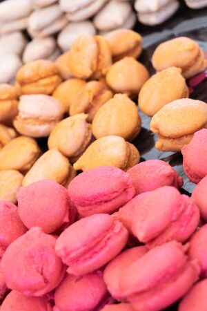 Bunch of macaroons with caramel, raspberries and hazelnut delicious traditional cakes Production and tradition of Provence, France, C?te dAzur, orange festival 2018