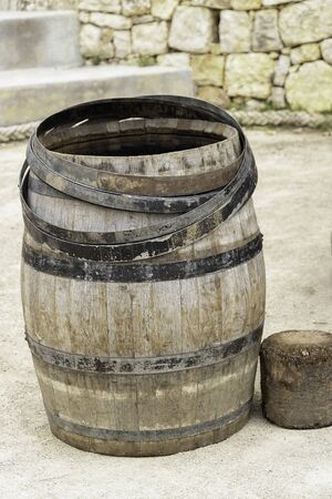 Traditional and artisanal production of a wine barrel by a master cooper in the south of France in Provence wood and metal