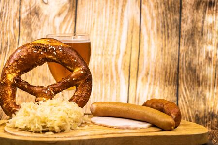 Oktober Fest with a glass of beer and a giant pretzel 写真素材