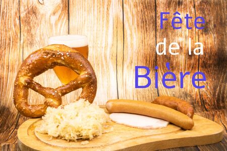 Beer Festival (beer festival is Oktober Fest in the french speaking countries) text in French in the colors of Munick blue and white with a glass of beer a giant pretzel and a sauerkraut garnished on a plate