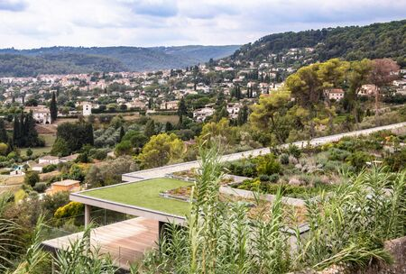 Treed roof - garden on the roof of a modern building in Saint Paul de Vence in the Alpes-Maritimes French Riviera Provence France with view on the village of La Colle sur Loup - aesthetic urbanism