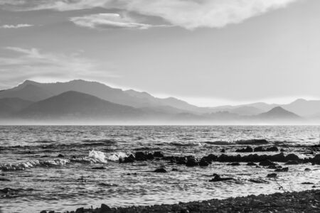 Black and white photo of the seascape of the Bay of Cannes seen from the Lérins islands on the Estérel