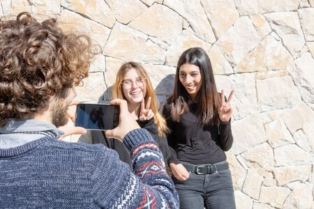2 young women posing with the fingers of the camera - photos with friends 写真素材