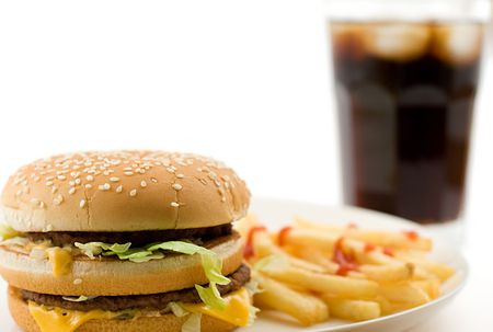 junkfood: cheeseburger, soda drink and french fries, shallow DOF, shot on white