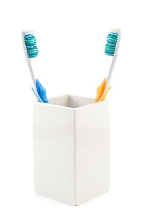 toothbrushes in cup, shot on white photo