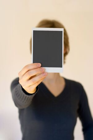 woman holding empty card in front, shallow DOF Stock Photo - 2908602