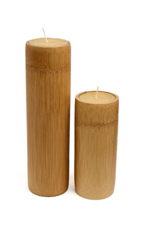 unlit: two wooden unlit candles, isolated on white