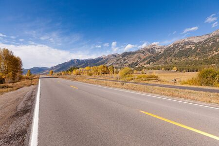 empty road in grand teton national park photo