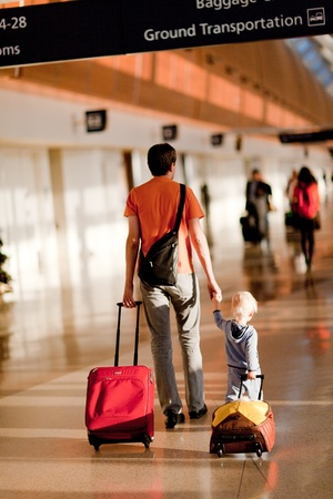 father and son with the luggage in the airport Stock Photo
