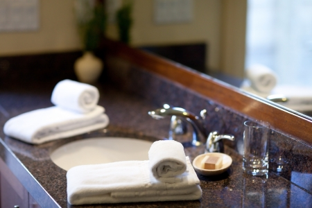 luxury hotel room: faucet and towels in a modern clean bathroom Stock Photo