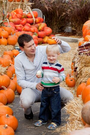happy father and son at the pumpkin patch photo
