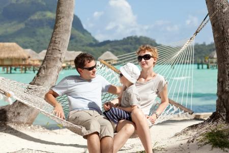 tahiti: happy caucasian family enjoying time together at the beach Stock Photo