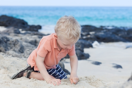 little kid playing at the hawaiian beach photo