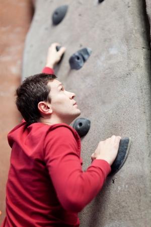 young caucasian man rock climbing indoors Stock Photo - 18424746