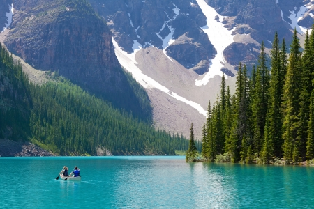 boating at beautiful moraine lake at banff national park, alberta, canada Stock Photo
