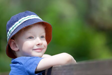 cute smiling boy in a sunhat outdoors photo