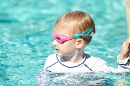 adorable positive boy in the swimming pool photo