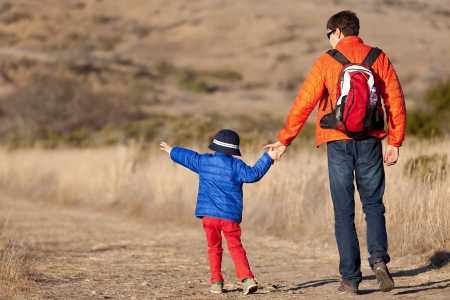 positive family of two hiking together photo