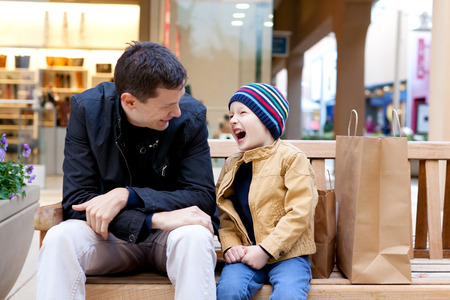 cheerful smiling family of two shopping together photo
