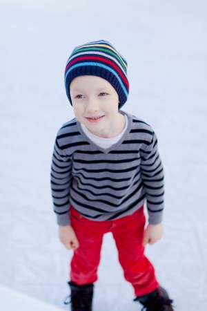 cute little boy enjoying ice skating photo