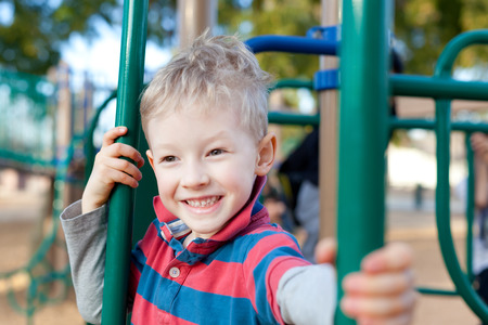 cheerful positive kid spending fun time at the playground Stock Photo