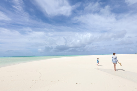 motu: family of two at picture perfect motu at aitutaki island, wide angle photo Stock Photo