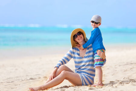 motu: little boy hugging his mother at the beach