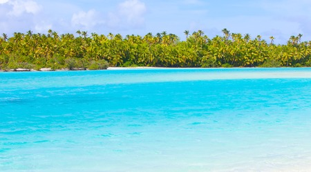 view at picture perfect island, turquoise lagoon at aitutaki, cook islands