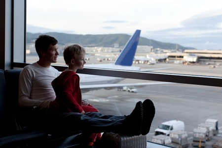 family at the airport waiting for departure
