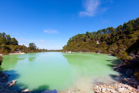 geothermal lake at wai-o-tapu, new zealand photo