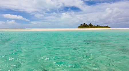 motu: panorama of picture perfect island and breathtaking turquoise lagoon at cook islands, aitutaki Stock Photo