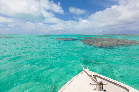 motu: boating in aitutaki lagoon, cook islands