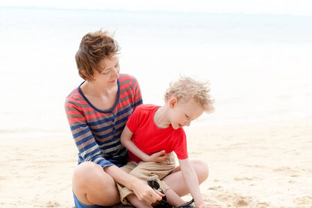 motu: happy mother and son enjoying time together at the beach