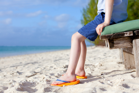 childs feet at the tropical beach photo