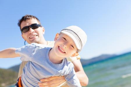 cheerful family of two having fun during vacation at lake tahoe, california, usa photo
