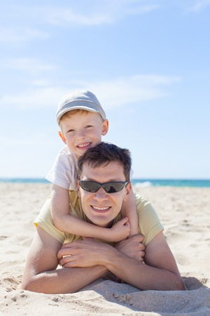 family of two having fun at the beach photo
