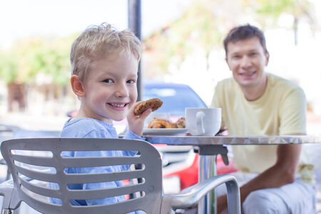 family of two enjoying desserts at outside cafe photo